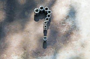 Metal nuts forming a question mark